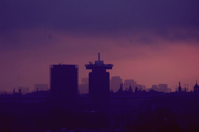 @adamlookout sillhouette with rainclouds on top and sunlight in the back. Architecture Building Exterior Skyscraper Cityscape City Built Structure Modern Sunset Urban Skyline Silhouette No People Outdoors Sky Travel Destinations Nature Day ADAMtower Amsterdam Skyline Cityscape