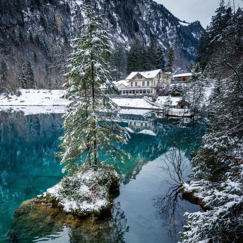 blausee near kandersteg Blausee Kandertal Berner Oberland Kandersteg Mountain Snow Winter Water Cold Temperature Scenics House Landscape Travel Destinations Nature Tranquil Scene Built Structure Outdoors No People Beauty In Nature