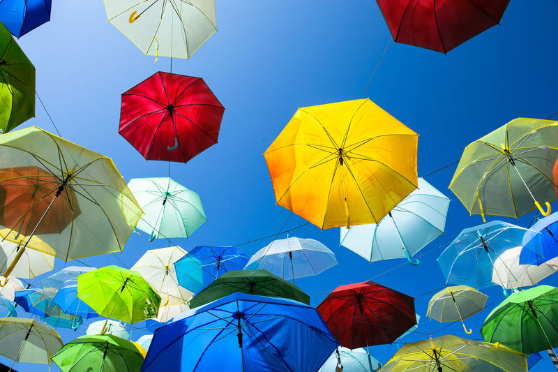 Lots of umbrellas coloring the sky in the city of Pai, Thailand Blue Choice Clear Sky Day Decoration Directly Below Hanging Large Group Of Objects Low Angle View Multi Colored Nature No People Outdoors Protection Rain Safety Security Sky Sunlight Umbrella Variation