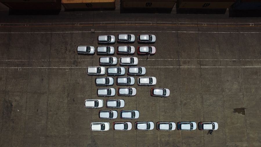 Directly Above Shot Of Cars In Parking Lot