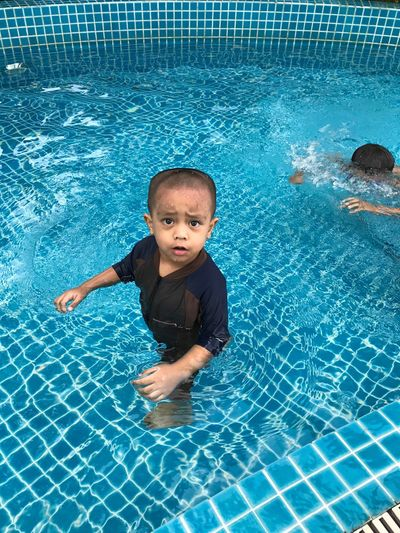 High Angle Portrait Of Boy In Swimming Pool