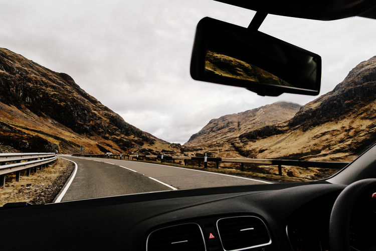 Glencoe, Scotland Car Car Interior Car Point Of View Driving Glencoe Journey Landscape Mountain Nature Road Road Trip Scotland Scottish Highlands Sky Steering Wheel Vehicle Interior Windshield