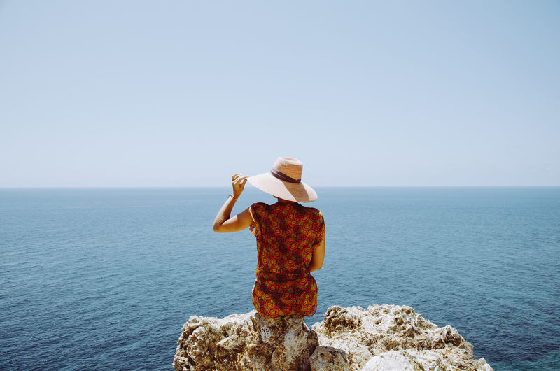 Beauty In Nature Blue Calm Day Girl And Sea Girl Looking To Left Hat Hat And Dress Horizon Over Water Non-urban Scene Ocean Outdoors Remote Romantic Landscape Romantic Place Romantic Scenery Sea And Sky Seaside Tranquil Scene Tranquility Water Woman Portrait Woman Power Market Reviewers' Top Picks