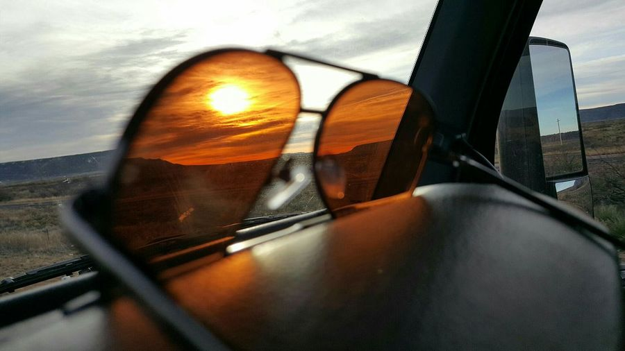 Near And Far Through The Windshield Enjoying The View View From My Office Cellphone Photography Samsung Galaxy S6 Edge Through The Window Traveling My Desk At Work My Office Today Sky And Clouds Dashboar Selective Focus The World Around Me Lonely Road Horizon Sunglasses Sunset Taking Pics While Driving Truckinglife
