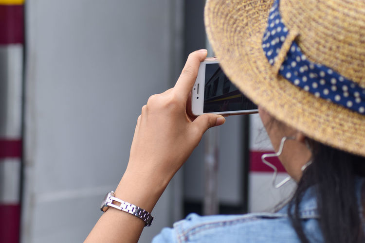Woman watching video in mobile phone outdoors