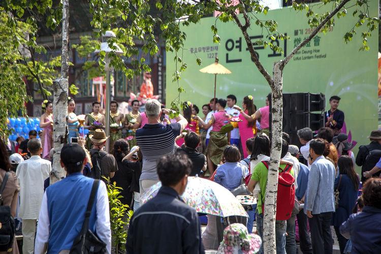 People Celebrating Buddha Birthday In City