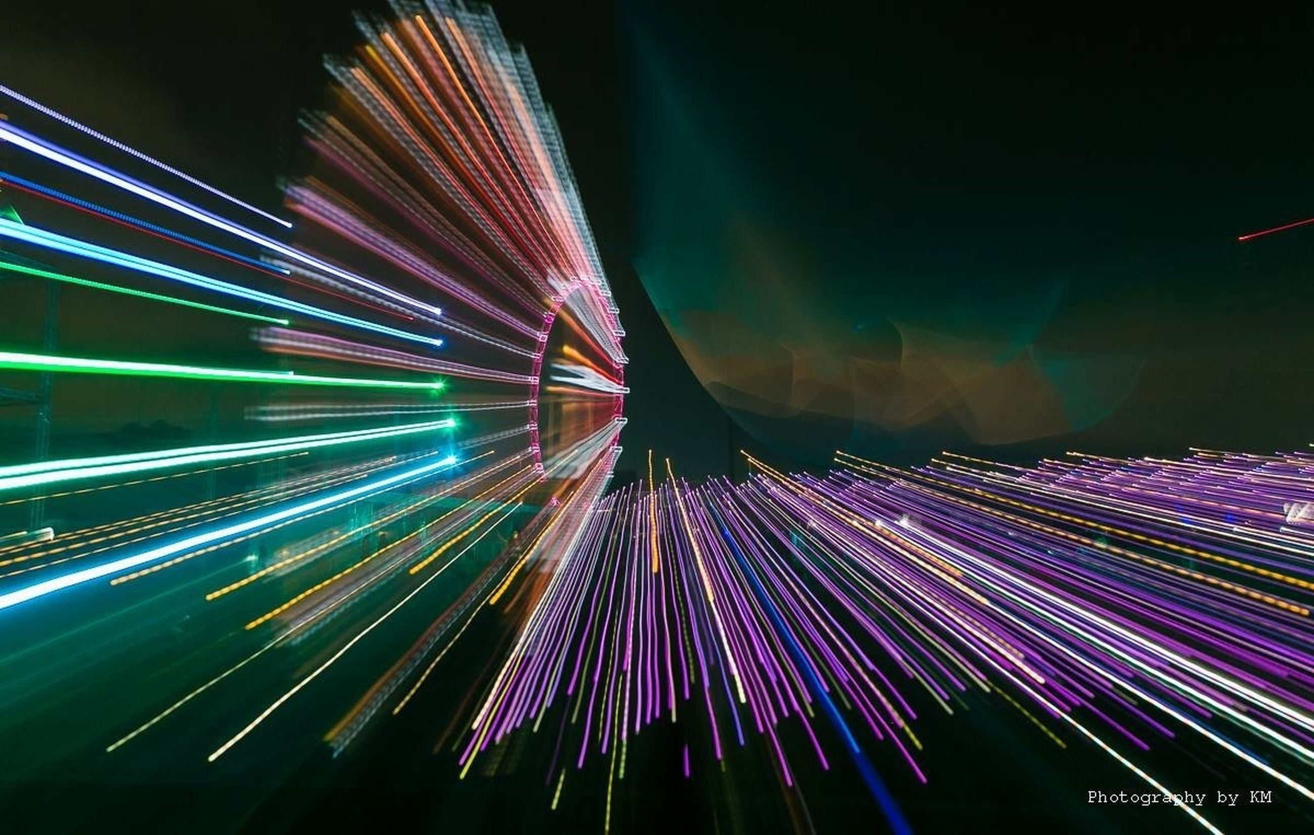 illuminated, night, long exposure, light trail, motion, multi colored, blurred motion, speed, lighting equipment, glowing, arts culture and entertainment, light - natural phenomenon, celebration, light, event, firework display, colorful, outdoors, transportation, abstract