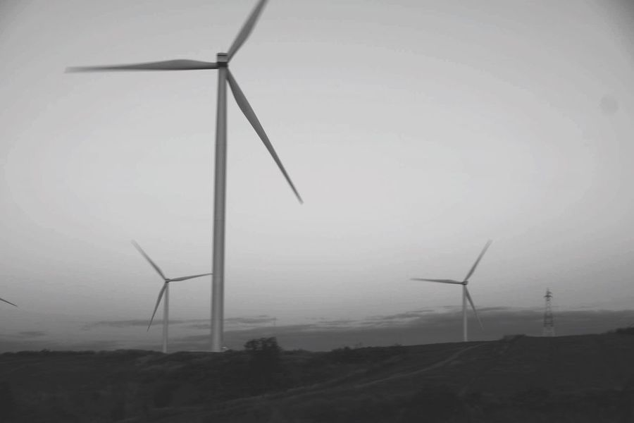 Wind Power Wind Turbine Alternative Energy Environmental Conservation Fuel And Power Generation Renewable Energy Windmill Sky Fog Sustainable Resources Landscape Outdoors Rural Scene Technology Nature No People Industrial Windmill Traditional Windmill Day Field