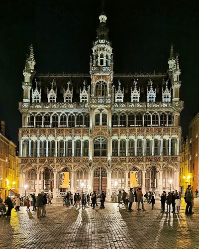 Group of people in front of building at night