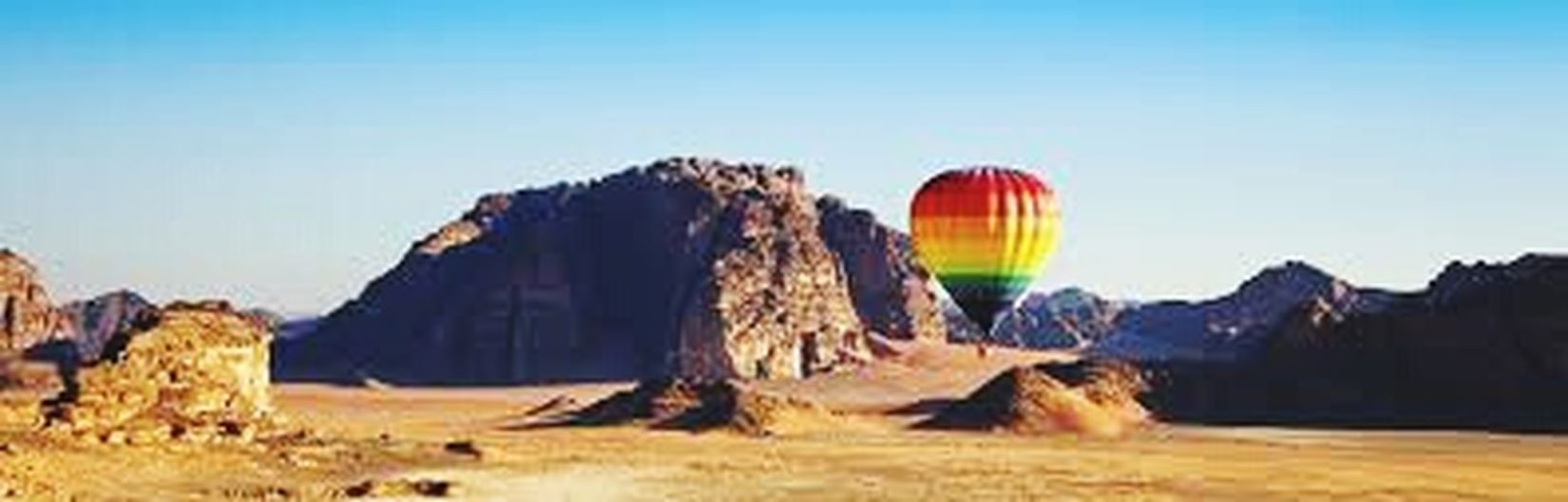 Flying Hot Air Balloon One Person Multi Colored Outdoors People Sky Day Sports Helmet Animal Themes Large Group Of Animals