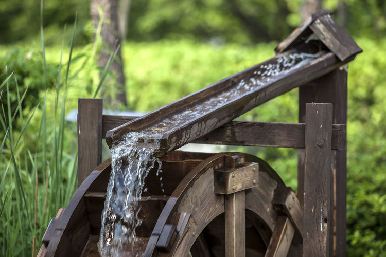 Close-up of traditional water wheel