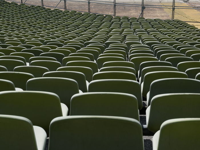 Absence Abundance Arrangement Backgrounds Bleachers Chair Day Empty Full Frame Green Color In A Row Large Group Of Objects No People Order Pattern Repetition Seat Side By Side Sport Stadium 17.62°
