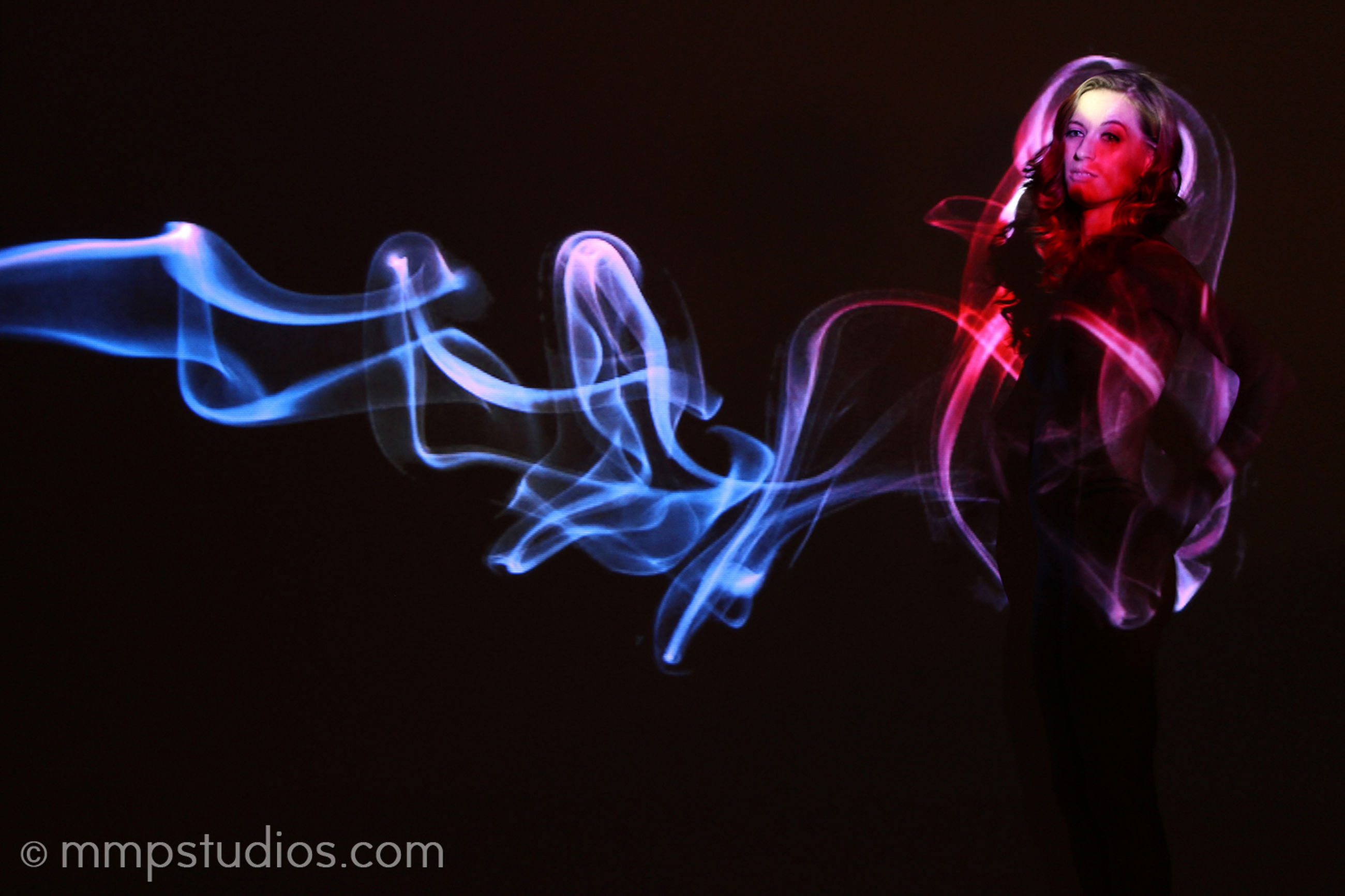 studio shot, indoors, motion, black background, smoke - physical structure, illuminated, long exposure, abstract, close-up, one person, pattern, glowing, arts culture and entertainment, creativity, young adult, light - natural phenomenon, nature, women, art and craft, flowing