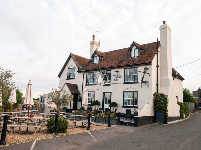 The Ship Inn,Conyer Marina Kent England. It is said that a quarter of all the vessels engaged in smuggling nationwide were based in Kent and Sussex and Conyer certainly played its part as a smuggling community in the 18th and 19th century. A short walk north along the creek to the Swale easily shows how remote and suitable for smuggling the area would have been in the past. Coastline Conyer Harbor Harbour Marina Royal Cinema Theatre United Kingdom Architecture Building Building Exterior Built Structure Red Sails Residential District Sailing Smuggling Street Tourism Town Town Square Travel Destinations Vivid International Water Pump Waterfront Yacht