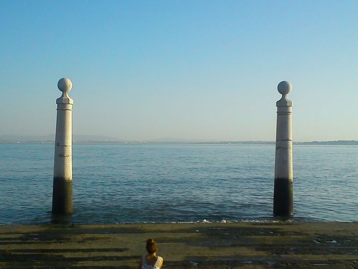 Sea Water Horizon Over Water Clear Sky Outdoors Tranquility Day Sky Landscape People Lisbon Lisboa Portugal Urban Exploration City River Tejo Tranquility Cais Das Colunas Thinking About Life One Person Finding New Frontiers Adapted To The City