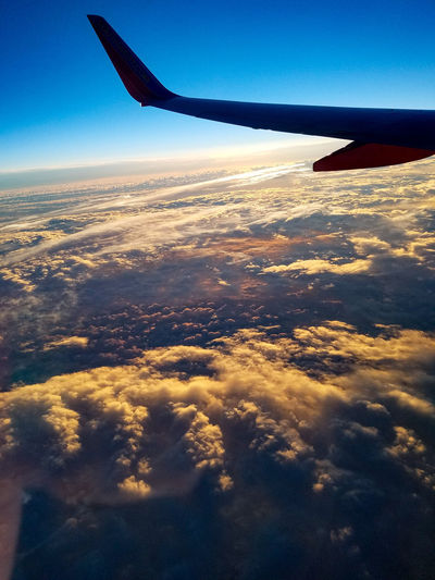 Flying Airplane Aerial View Air Vehicle Mid-air Outdoors Aircraft Wing Sky No People Blue Nature Aerospace Industry Day Commercial Airplane Beauty In Nature May 2017 Sunrise Flying High Southwest Airlines Veiw From Above Looking Down Window Seat Airplane Wing Window Seat Clouds Over The Clouds The Great Outdoors - 2017 EyeEm Awards