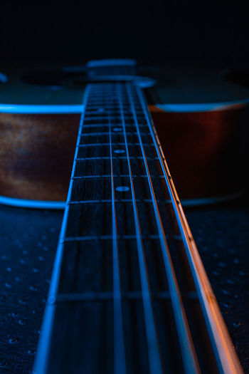 Guitar on a black background.  strings