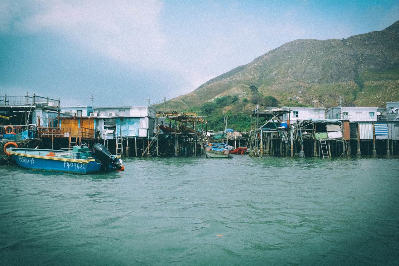Stilt houses and moored motorboat