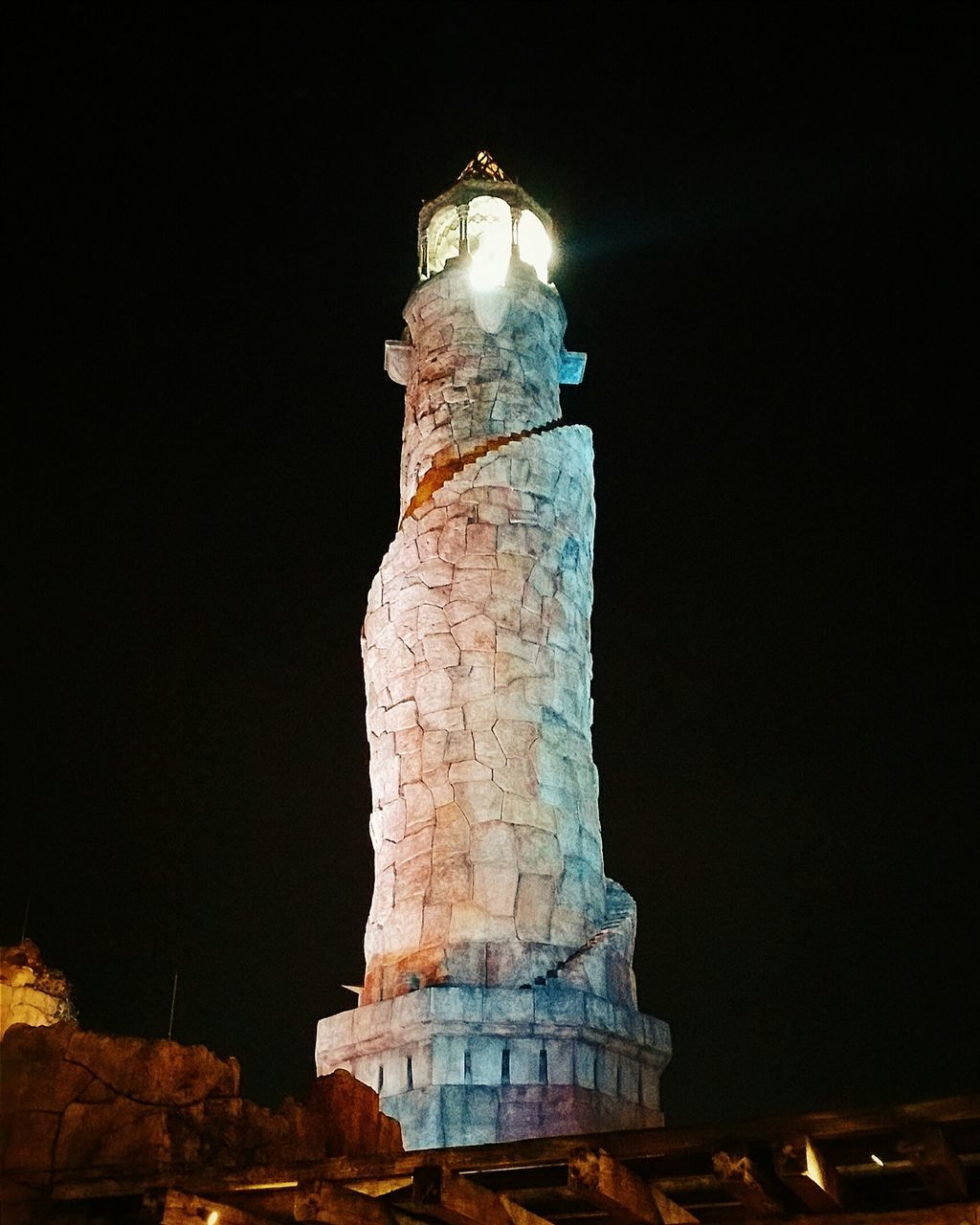 night, statue, low angle view, no people, illuminated, sculpture, history, architectural column, old ruin, travel destinations, built structure, architecture, outdoors, sky, ancient civilization, close-up