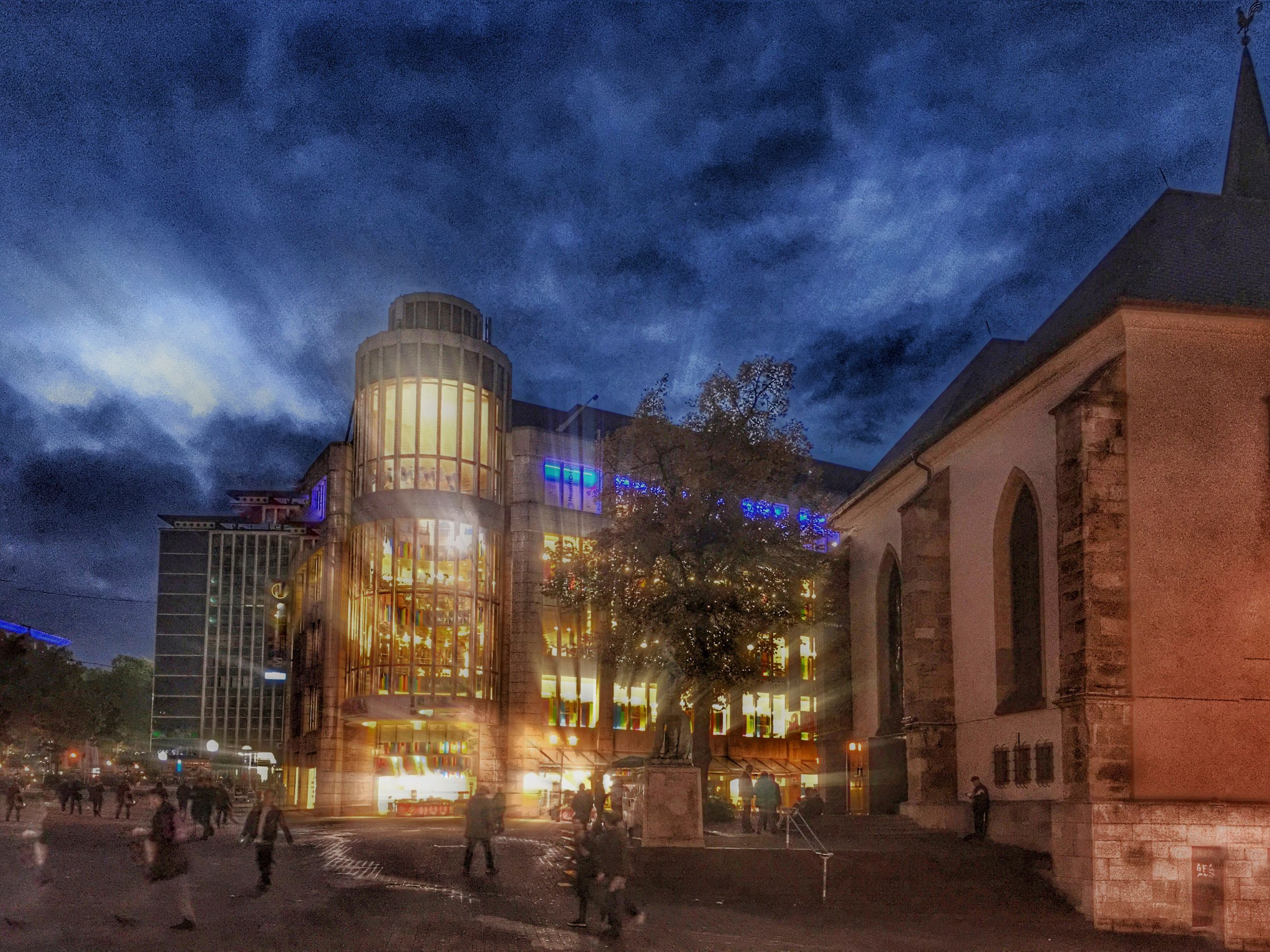 building exterior, architecture, built structure, illuminated, night, sky, cloud - sky, city, building, street light, cloudy, low angle view, dusk, lighting equipment, outdoors, tree, residential building, city life, facade, residential structure