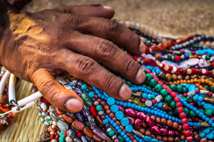 Close-up of man selling jewelry outdoors