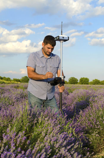Land surveyor tracing in a lavender field Boundary Field Flower Geodesy Glonass GNSS GPS Keyboard Land Surveyor Lavender Layout Location Measurement Mobile Controller Nature Ntrip Correction Outdoors Plant Pole Property Receiver Satellite Navigation Terrain Terrestrial Windows