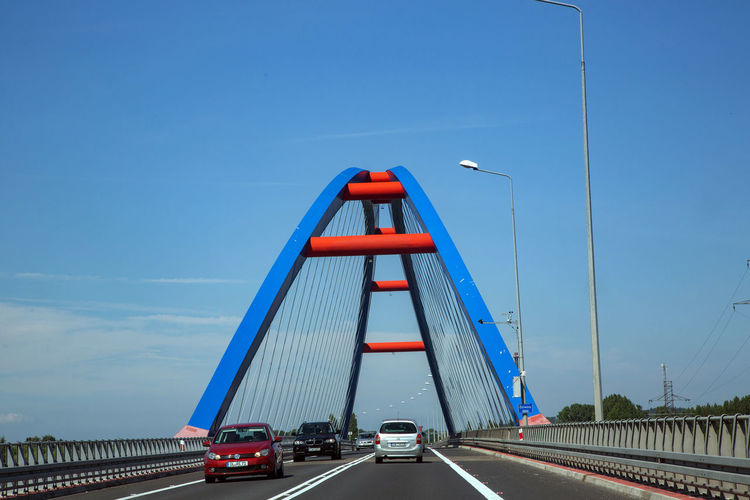 Architecture Blue Bridge Bridge - Man Made Structure Built Structure Car Connection Day Diminishing Perspective Direction Engineering Land Vehicle Mode Of Transportation Motor Vehicle Nature Outdoors Road Sky Suspension Bridge The Way Forward Transportation