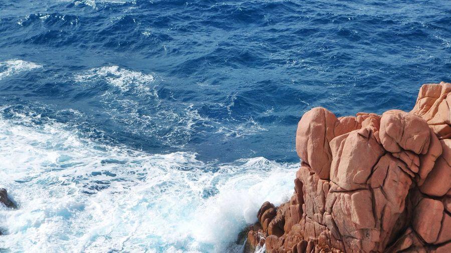 High Angle View Of Rock Formations At Seashore