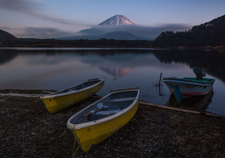 Water Nautical Vessel Transportation Mountain Mode Of Transportation Sky Tranquility Moored Tranquil Scene Reflection Beauty In Nature Lake Scenics - Nature Nature No People Beach Non-urban Scene Land Cloud - Sky Outdoors Rowboat Snowcapped Mountain Mt Fuji Japan Dusk Evening