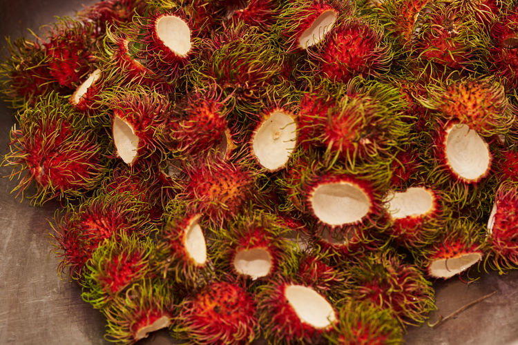 A group of rambutan shells after peel Rambutan Red Fruit Healthy Fresh Background Delicious Sweet Food Thai Natural White Closeup Colorful Tropical Nature Pattern Dessert Asian  ASIA Green Organic Fruits Hair Freshness Texture Thailand Juicy Health Summer Ripe Diet Tasty Nutrition Peel Group Eat Market Garbage Waste Food And Drink High Angle View Close-up Abundance Directly Above Tropical Fruit Large Group Of Objects Green Color Spiked