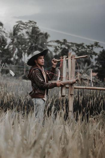 Man wearing hat standing at farm