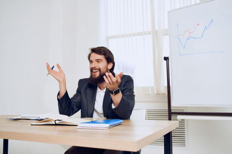 Man explaining graph at office