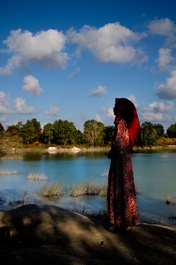 Standing still EyeEmNewHere Women Only Women Sky Blue Sky Water Lake Nature Water Rear View Adults Only Outdoors One Young Woman Only Day Colour Your Horizn