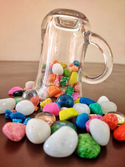 Close-up of multi colored candies in glass on table