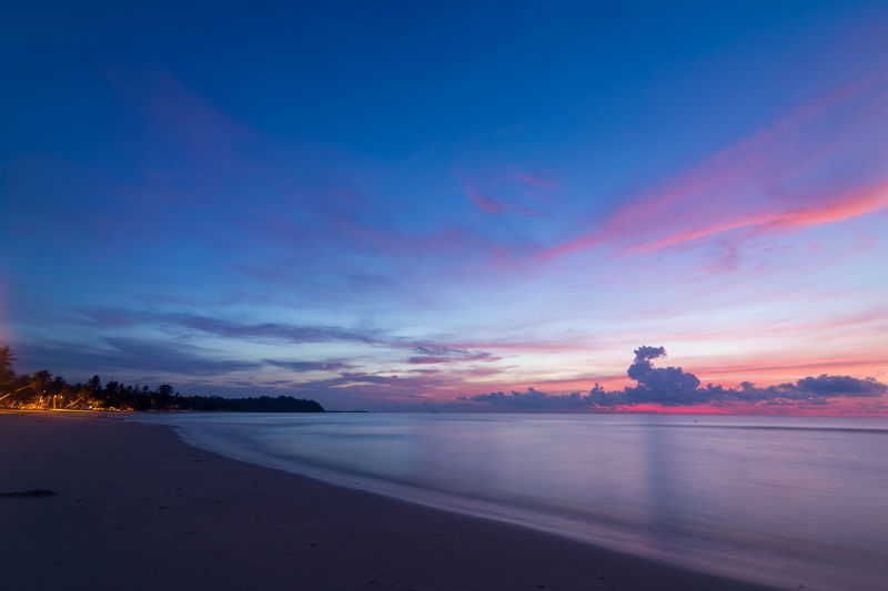 sunrise at Tung Wua Lan Beach Beach Beauty In Nature Blue Cloud - Sky Dusk Idyllic Land Nature No People Orange Color Outdoors Purple Scenics - Nature Sea Sky Sunset Tranquil Scene Tranquility Tree Water