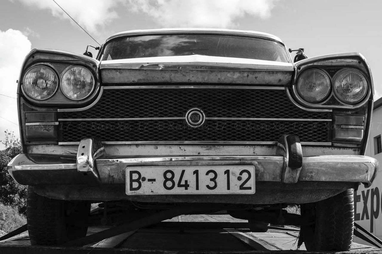 headlight, transportation, front view, car, old-fashioned, retro styled, day, no people, outdoors, frothy drink, sky, close-up