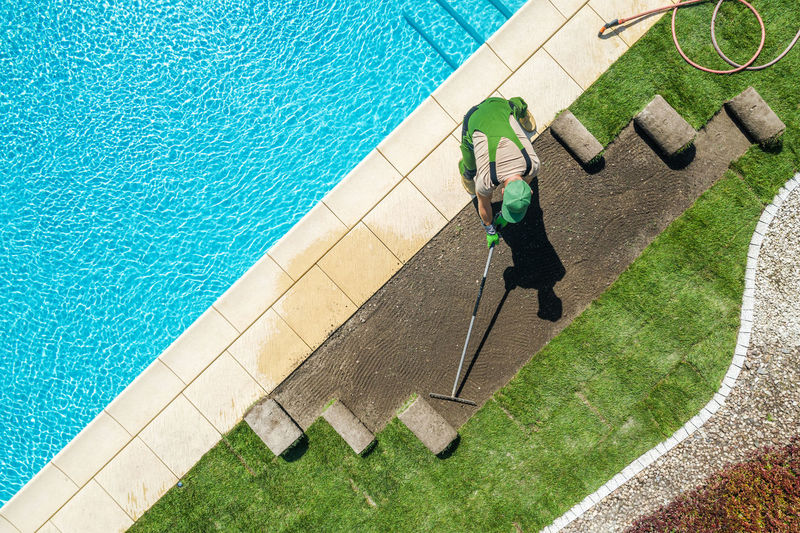 High angle view of man working by swimming pool
