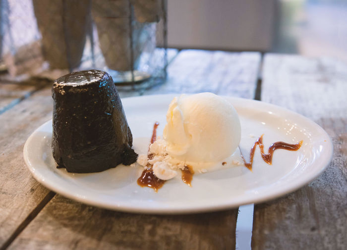 Chocolate volcano with ice cream. Food Sweet Food Sweet Dessert Freshness Table Plate Ready-to-eat Ice Cream Temptation Frozen Food Close-up No People Chocolate Chocolate Volcano Sauce Delicious Wood Wood Table Horizon Over Water Tasty