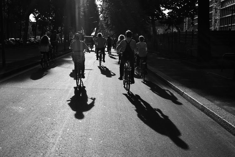 CyclingUnites Shadow Lifestyles Leisure Activity Silhouette City Outdoors People Large Group Of People Light And Shadow Bicycle m Streetphoto_bw Blackandwhite Black And White Black & White Bikers Embrace Urban Life