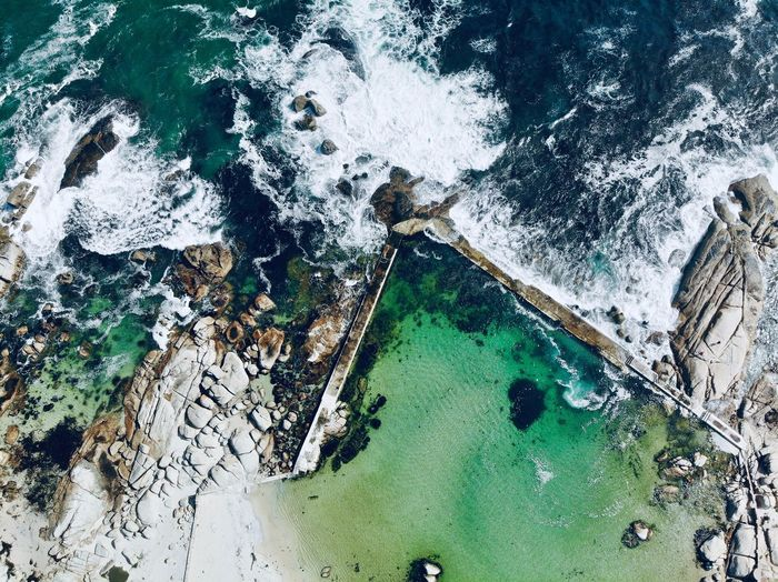 Aerial Natural Pool Tidal Pool South Africa South Africa 🇿🇦 Cape Town Camps Bay Aerial Photography Aerial View DJI Mavic Air Dronephotography Amazing View High Angle View Day No People Water Nature Green Color Full Frame Built Structure Reflection Backgrounds Growth Architecture Sea Outdoors Land Beauty In Nature Close-up