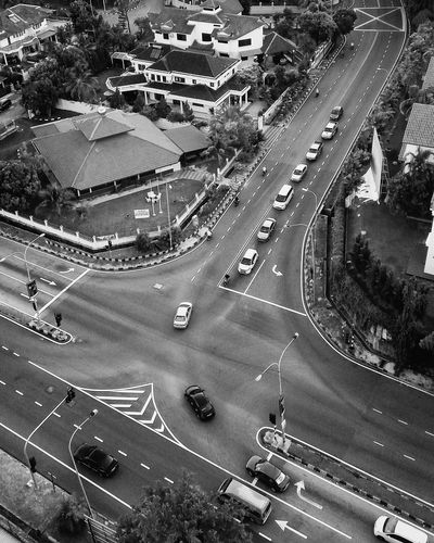 Aerial view of cars on road