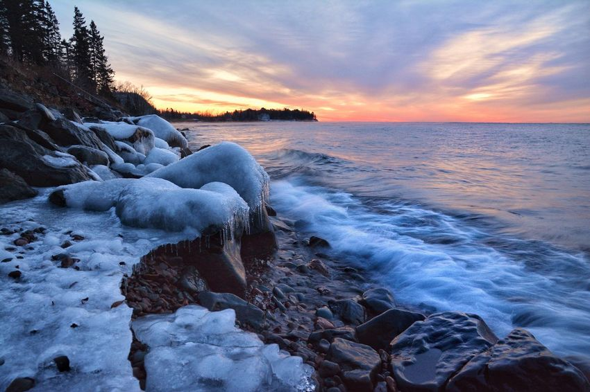 Icy sunrise on Lake Superior Sunset Sea Beauty In Nature Nature Sky Cloud - Sky Water Rock - Object Cold Temperature Scenics No People Dramatic Sky Ice Malephotographerofthemonth Lake Superior Winter Minnesota Beauty In Nature Lakesuperior Nature Frozen Beach Horizon Over Water Wave Day