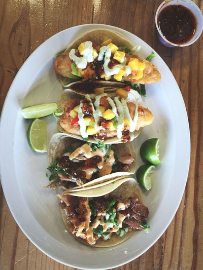 High angle view of tacos served in plate on table