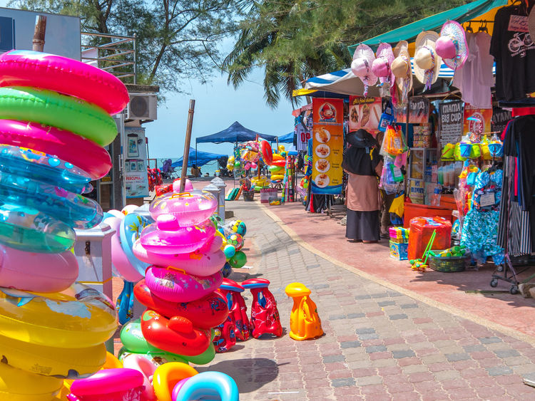 inflatable, float buoy for kids on the left. Buoy For Children Multi Colored Market Stall Retail  Market Choice Variation Amusement Park