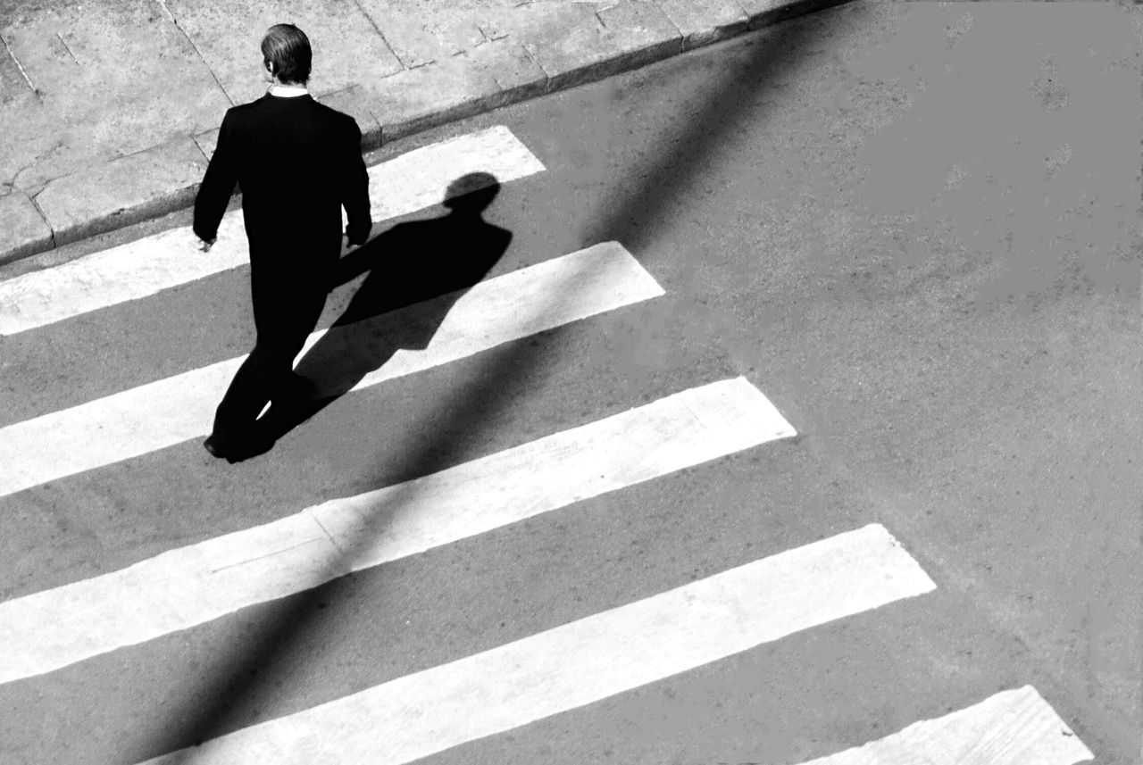 High angle view of man crossing the road