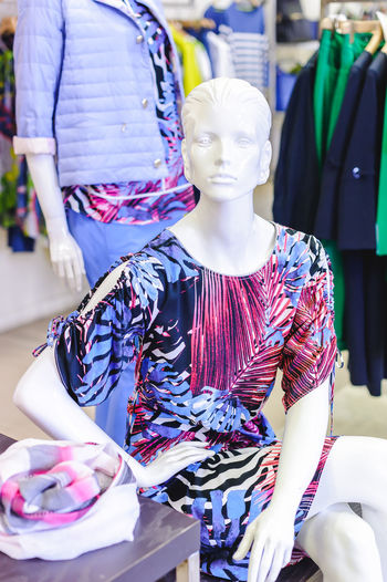 Clothing on mannequin for sale at store