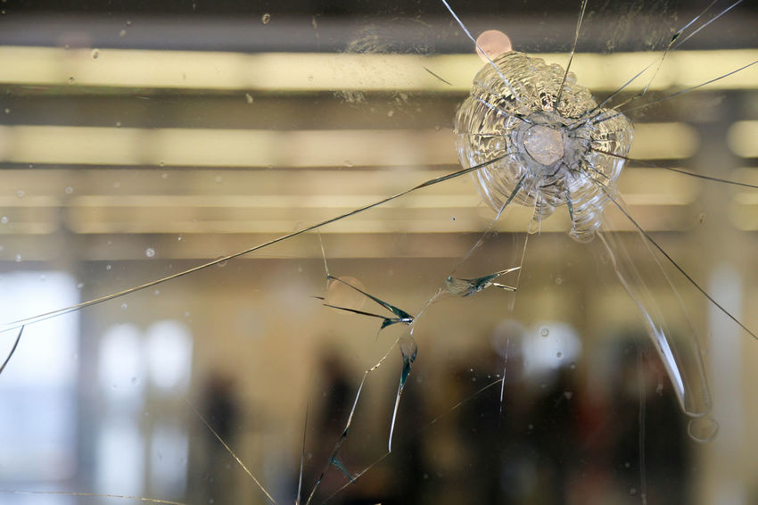 Broken Glass Circle Showcase July Complexity Danger Day Focus On Foreground Fragility Glass Natural Pattern Nature Power Power Supply Selective Focus Shopping Shot Spider Web Twig Violence Weather Web Cracked Amok Pistol