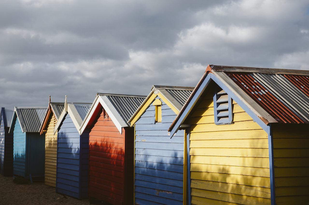 Row Of Beach Huts Against Sky