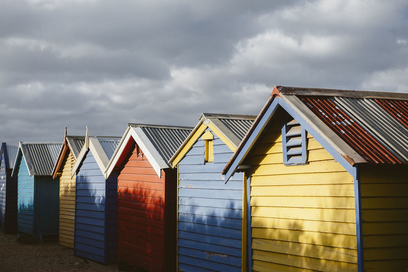 Row of beach huts against sky