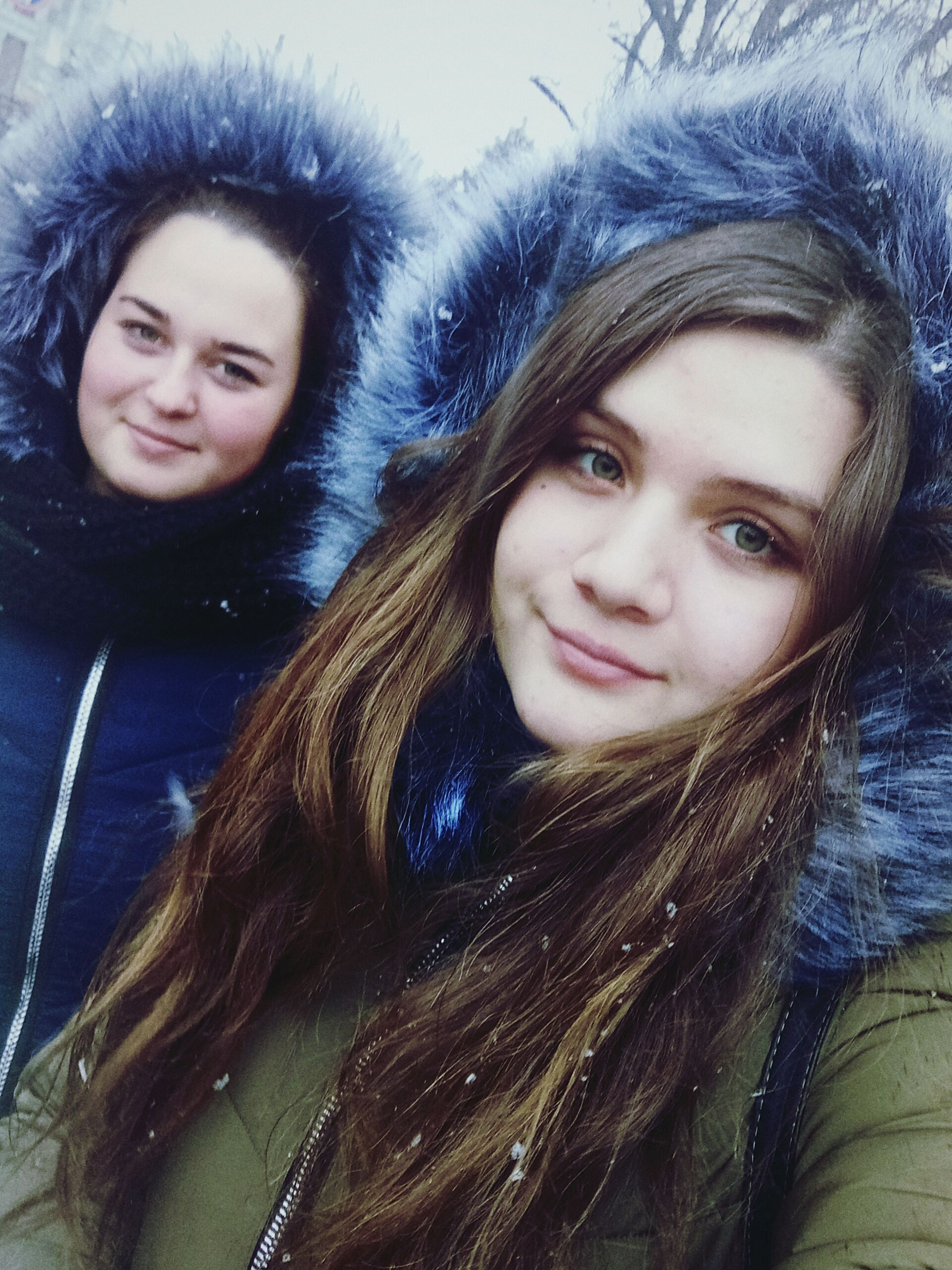 looking at camera, portrait, real people, winter, two people, warm clothing, smiling, young women, cold temperature, front view, long hair, teenage girls, lifestyles, young adult, jacket, togetherness, happiness, leisure activity, snow, friendship, outdoors, beautiful woman, day, nature, close-up